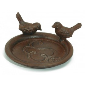 The pot saucer - with birds, rusted